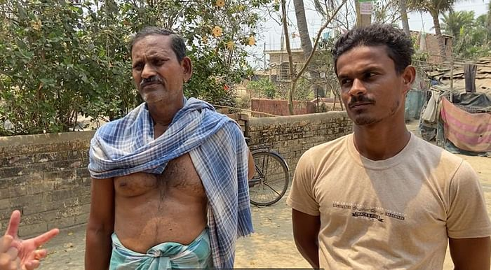 Rajab (left) and his son Rahman are both TMC party workers.