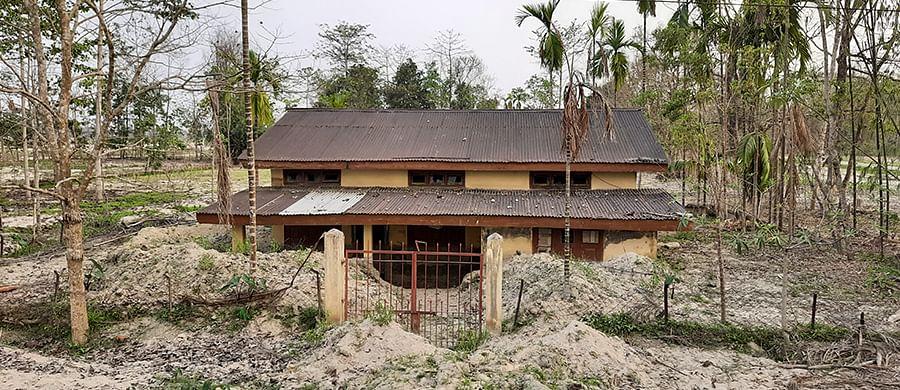 A house half buried in sand in Kekuri.