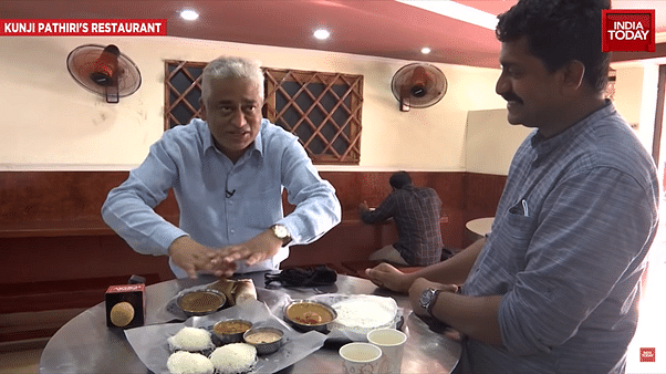 Rajdeep demonstrating how different dishes on a table is the 'genius' of Kerala's secularism.