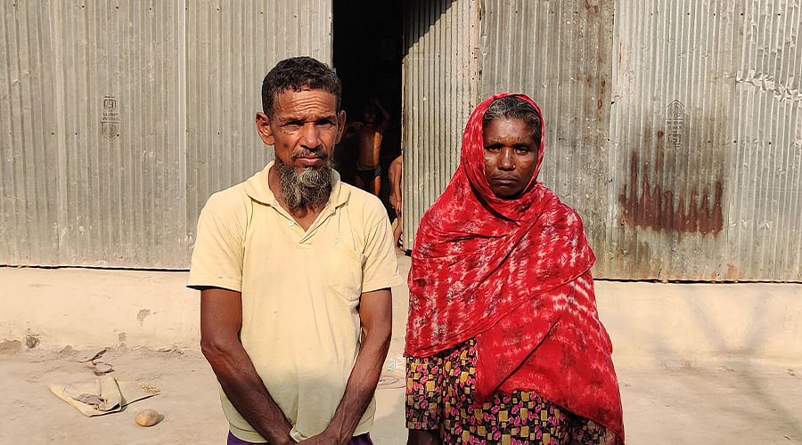 Noor Islam's parents outside their home.