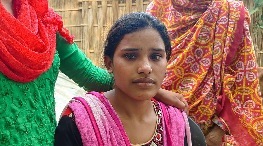 Anjupa Khatun outside her home.