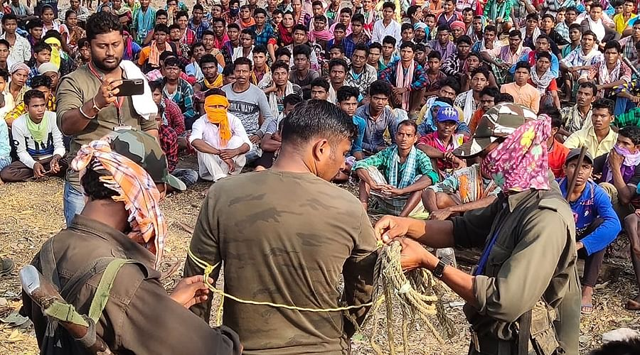 Manhas being untied by Maoists at the jan adalat.