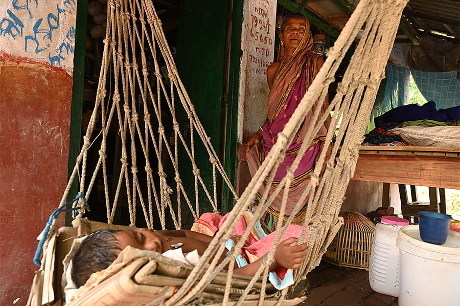 Usha Mondal is unable to keep calm as she worries about the future of her two-year-old grandson. The income from her family-run shop in Mousuni is barely enough to live on. The rain and floods make her feel like she's on a sinking ship.