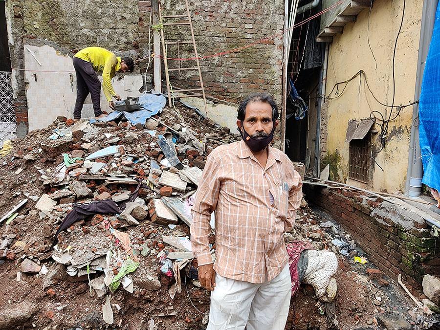 Rafiq Siddique surveys the wreckage of his house.