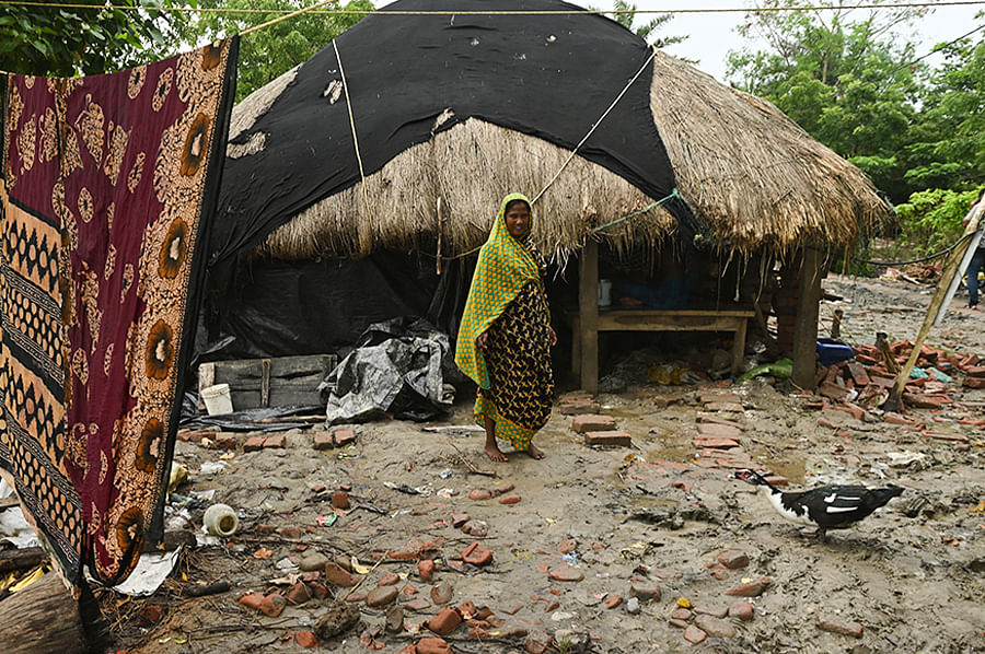 Saukat, with his mother and ailing grandfather, shifted into an abandoned cowshed after their house collapsed under fierce tidal pressure.