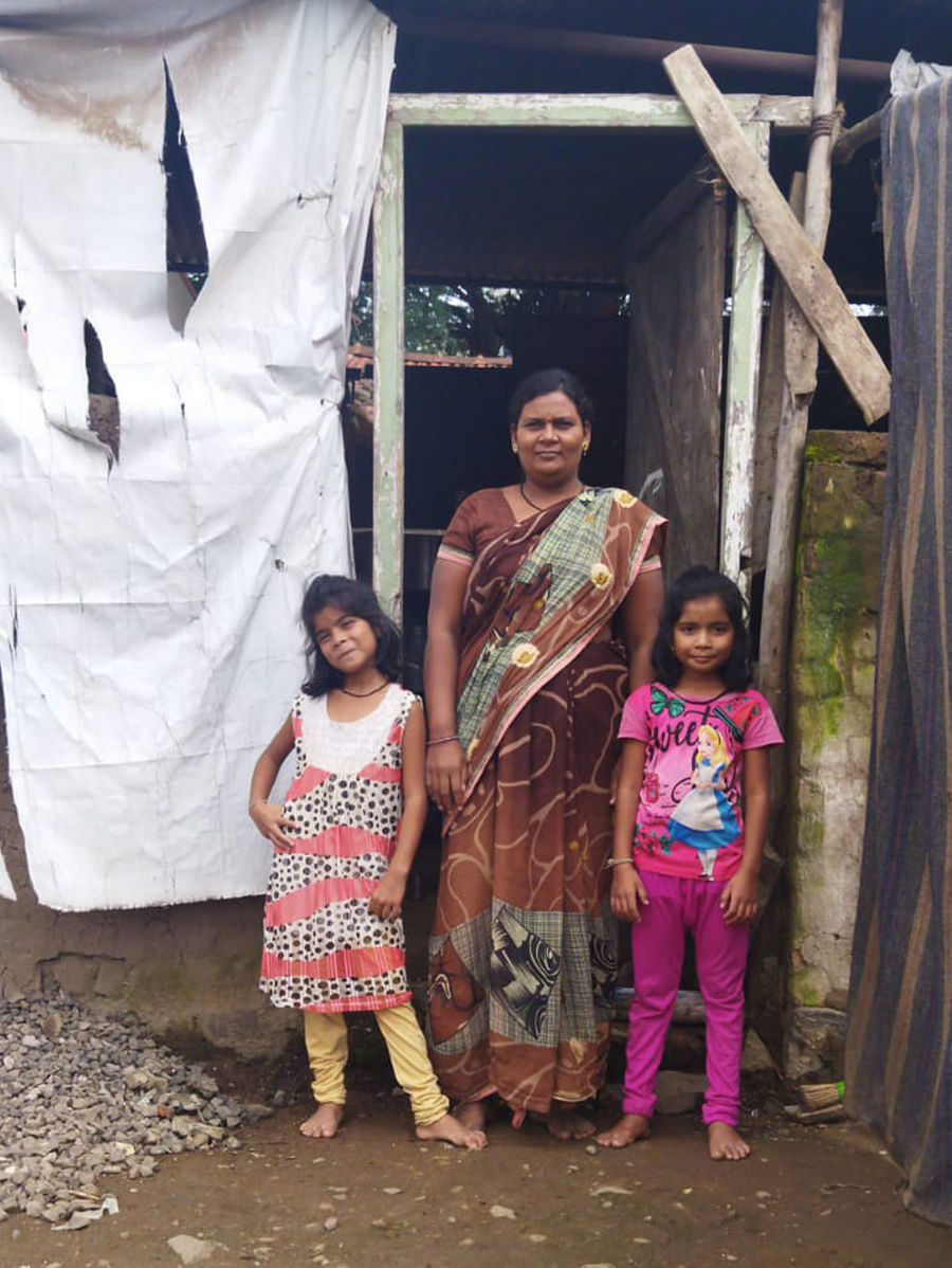 Kanchan Shinde with her children in Ahmednagar's Akole.