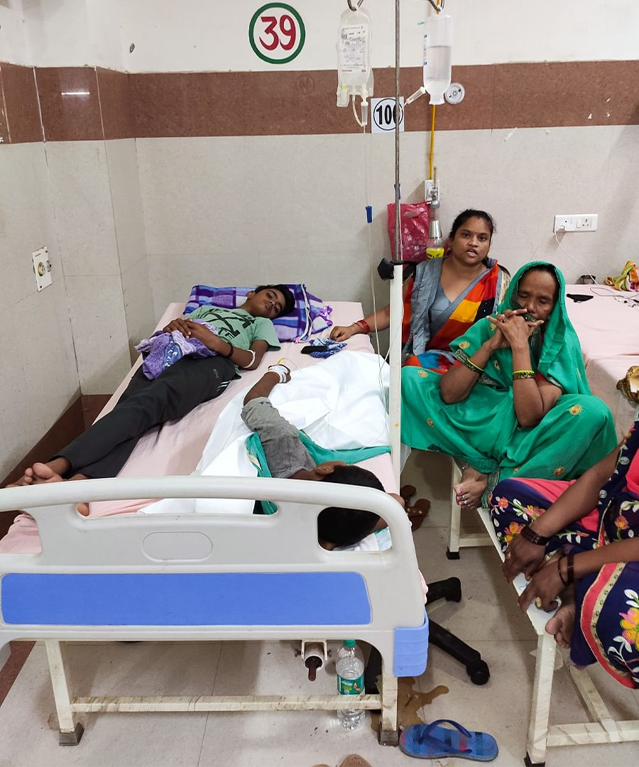 A hospital bed with two dengue patients.