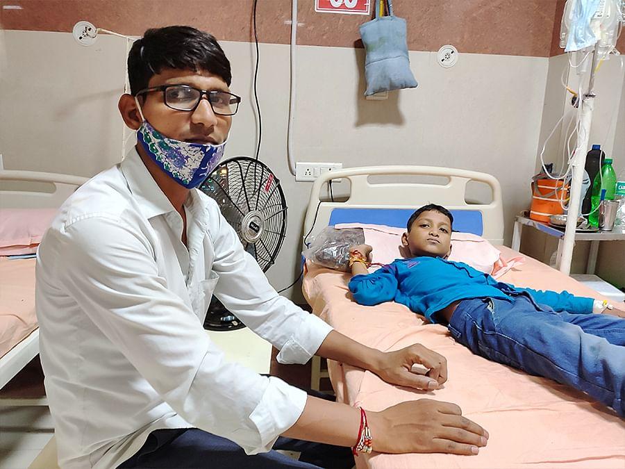 Sunil Kumar with his son Avijit, 10, at the hospital.
