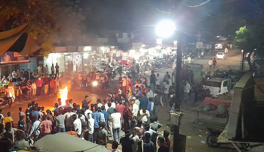 Locals burning effigy of the MP in Segaon.