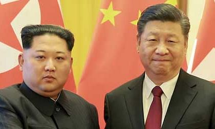 Kim, Xi to work for true peace