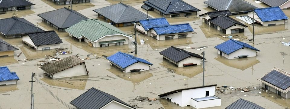 At least 60 killed in floods and landslides in Japan