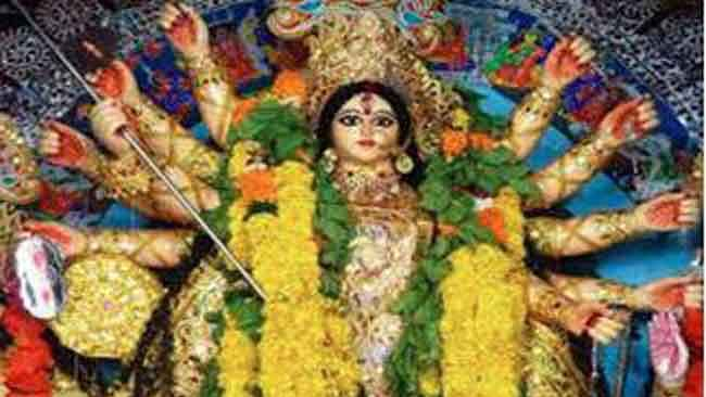 Crowd throng into street ahead of formal beginning of Durga puja