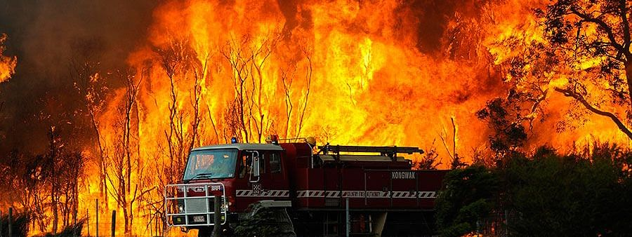 Firefighters work around the clock to battle monster wildfire in Australia