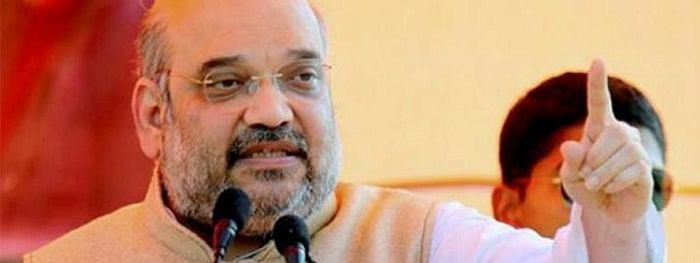 Cong should apologise for defaming Swami Aseemanad: Shah