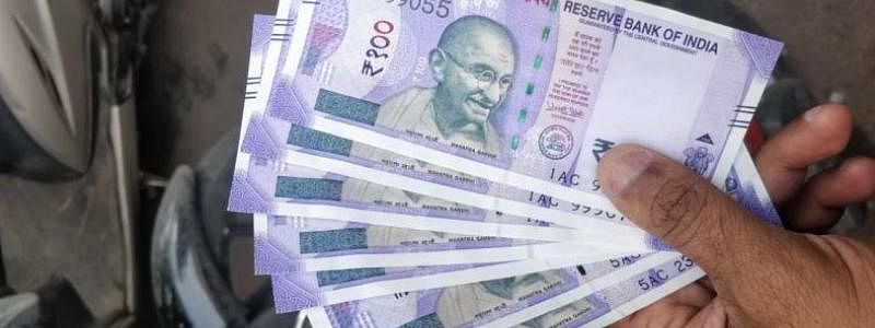 Rupee falls by 8 paise against USD