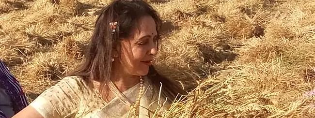 Hema Malini begins election campaign from a farm carrying sickle in hand