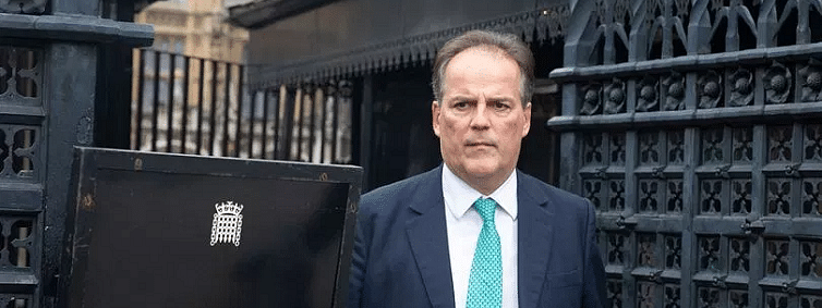 Mark Field suspended as minister after grabbing activist