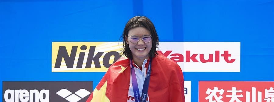 Xin Xin wins first gold for China