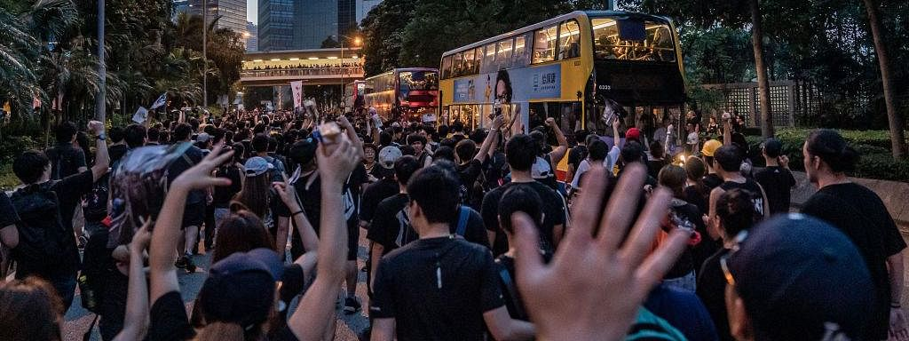 China warns protesters, backs Hong Kong leader