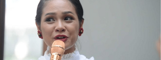 Indonesia singer Andien sleeps with tape on her mouth