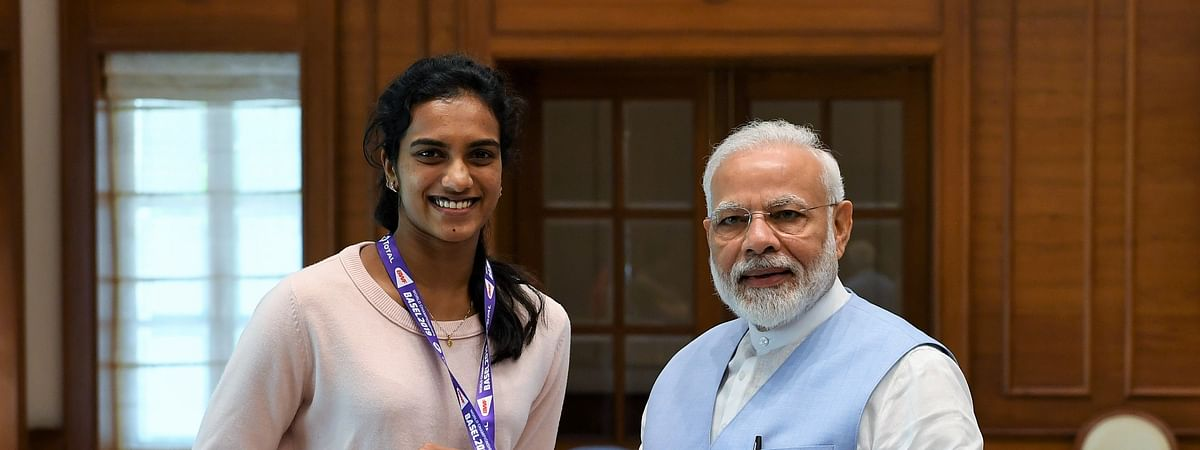 PM meets P V Sindhu, congratulates her for winning gold