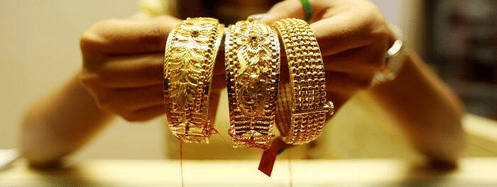 Gold touches new high