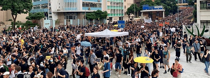 Protests continue despite storm in Hong Kong