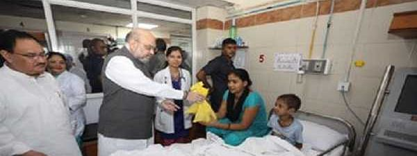 Shah, Nadda sweep floor at AIIMS as part of 'seva saptah'