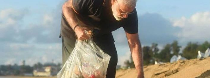PM cleans beach at resort