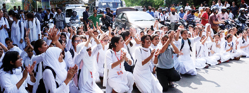Students up in arms over change in timings in Jammu, hold protest