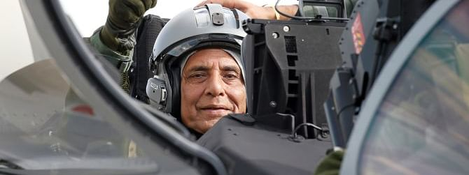 Rajnath becomes first Indian Min to fly in Rafale fighter jet