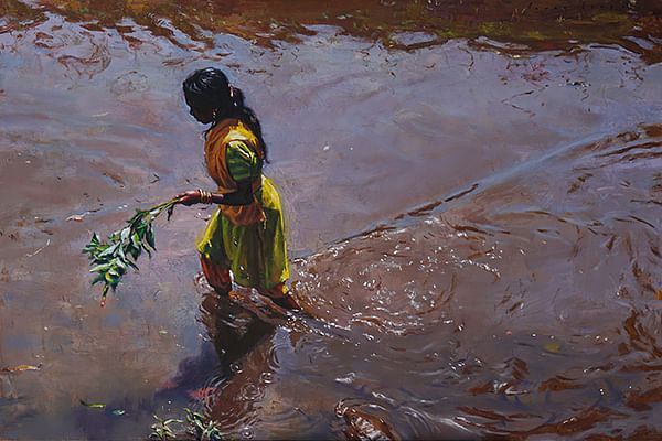 The girl wading through slimy waters of the river