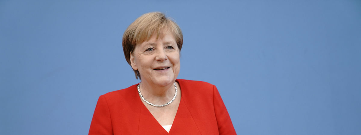 India to allow Angela Merkel to be seated during national anthem