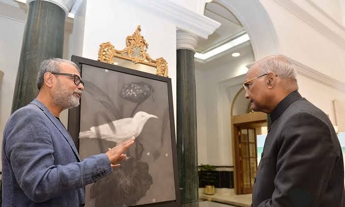 Prez views painting exhibition set up by Artists-In-Residence