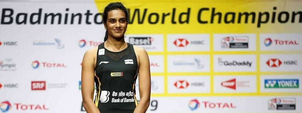 Sindhu enters round two, Saina bows out in opening round
