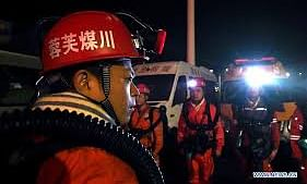 Four dead, 14 trapped in flooded mine in southwest China