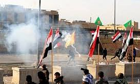 US troops fire teargas to disperse protesters at Baghdad embassy