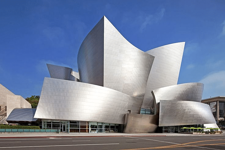 Walt Disney Concert Hall, Los Angeles, California. The Walt Disney Concert Hall at 111 South Grand Avenue in downtown Los Angeles, California, is the fourth hall of the Los Angeles Music Center and was designed by Frank Gehry. Reflecting Gehry's longtime passion for sailing, the structure's exterior features expanses of stainless steel that billow above Grand Avenue, while inside, similarly shaped panels of Douglas fir line the auditorium.