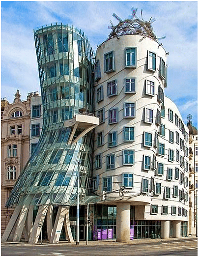Dancing House, Prague, Czech Republic. The Dancing House, or Fred and Ginger, is the nickname given to the Nationale-Nederlanden building. It comprises of a cinched volume of metal mesh and glass and a concrete cylinder. It was a collaboration between Gehry and local architect Vlado Miluníc.