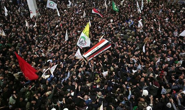 Mourners flood the streets as Soleimani's body goes to Iran