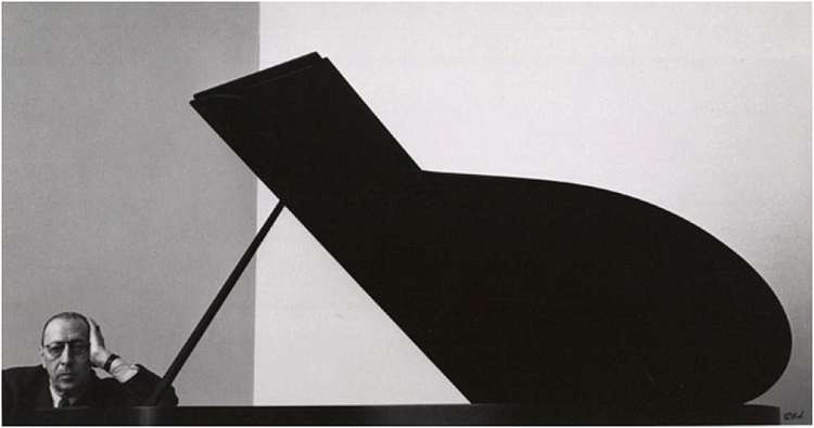 Portrait of Russian composer & pianist Igor Stravinsky. Newman uses a rather interesting and unusual composition by placing the composer at the bottom left corner while the lid of the grand piano takes the center stage. He uses symmetry, shapes curves and lines to create a visually striking environmental portrait.