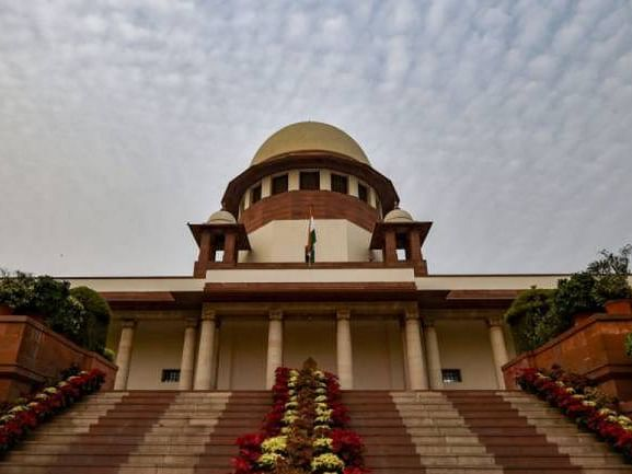 SC disposes of DMK plea on disqualification of OPS and others