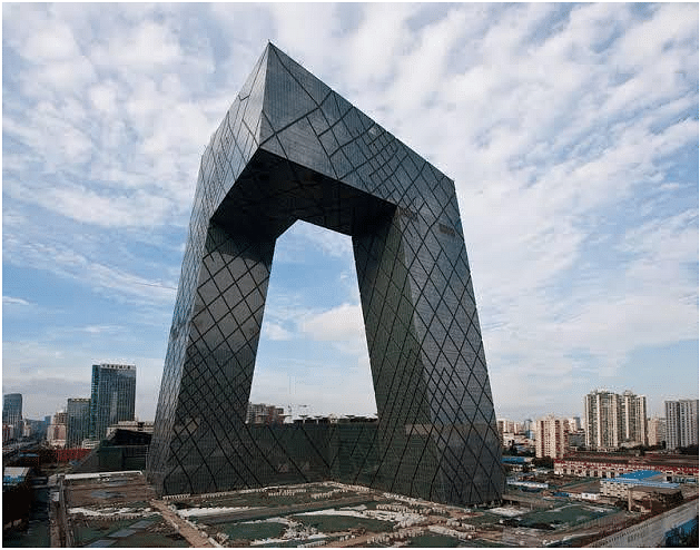 CMG Headquarters, Beijing China. The CMG Headquarters is a 234-metre (768 ft), 51-story skyscraper on East Third Ring Road, Guanghua Road in the Beijing Central Business District (CBD). The main building is not a traditional tower, but a loop of six horizontal and vertical sections covering 473,000 m2 (5,090,000 sq ft) of floor space, creating an irregular grid on the building's facade with an open center.