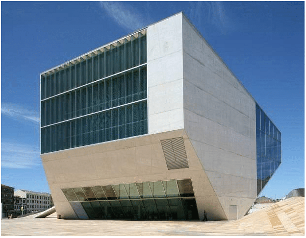 Casa da Música, Porto, Portugal. Designed to mark the festive year of 2001, in which the city of Porto was designated European Capital of Culture, Casa da Música is the first building in Portugal aimed from its conception to be exclusively dedicated to music, either in public performances, or in the field of artistic training and creation. The building is shaped as a nine-floor-high asymmetrical polyhedron covered in plaques of white cement, cut by large undulated or plane glass windows.