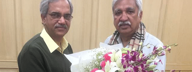 Delhi CEO Ranbir Singh greets CEC Sunil Arora on successful conduct of Assembly polls