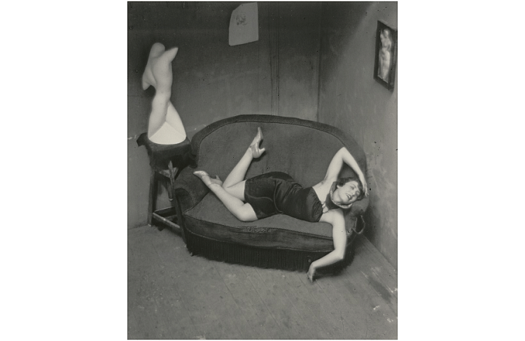Satiric Dancer – The composition of this photograph causes the viewer's eye to travel around the frame. The woman is trying to mimic the mannequin's body posture. Her body is placed in a way that the eye goes around her in a circular or elliptical manner – he right hand points towards her left hand, her left hand points down, her left leg points towards the mannequin while her right leg points up and so on. By wearing a dark dress only her limbs, her face and the mannequin are the brightest objects in the entire photograph thereby pulling the viewer's attention towards these parts.