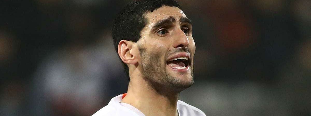 Shandong Luneng midfielder Fellaini leaves hospital after COVID-19 treatment