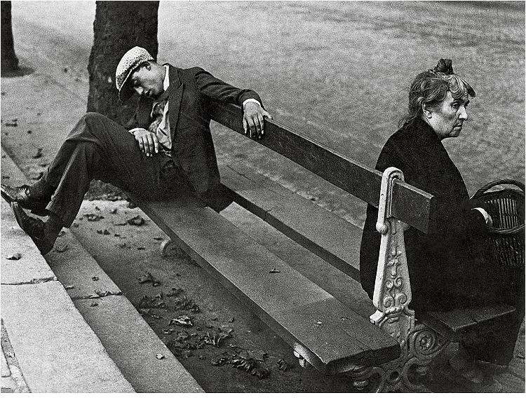 Montmartre, 1930-31. The pavement and the bench act as leading lines drawing the eyes towards the man and adding depth. There is a juxtaposition created as each person is sitting facing the opposite direction.