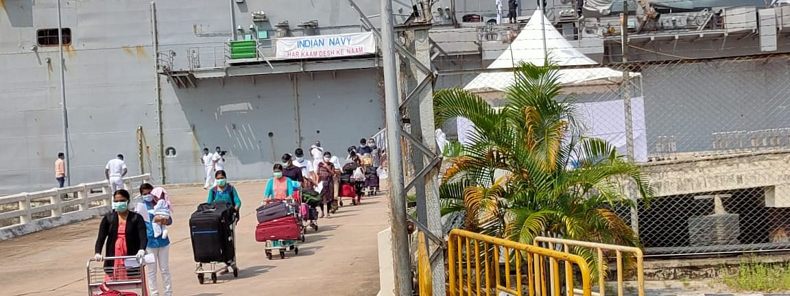 Passengers disembarking from the ship INS Jalaswa on arrival at Cochi Port on Sunday.