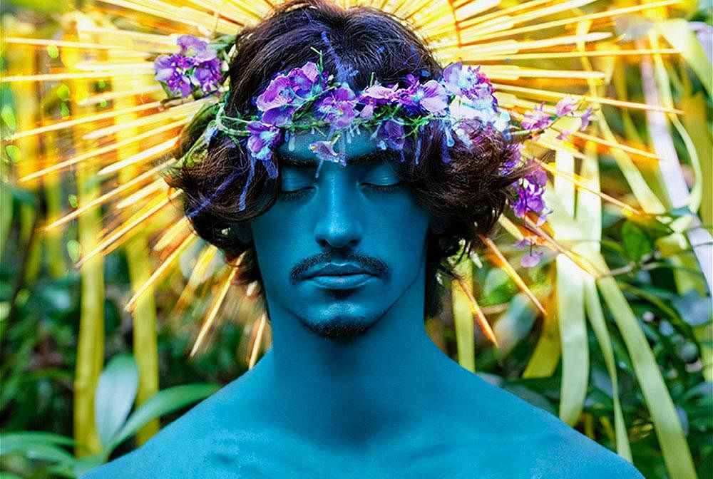 Behold (2017). This photograph is a Renaissance representation of Jesus with halos around his head. The unusual blue paint and the central composition ensures that the viewers entire attention is on the subject and nothing else. The material used to create the halo create a strong pattern ensuring the attention is drawn towards the subject's head.